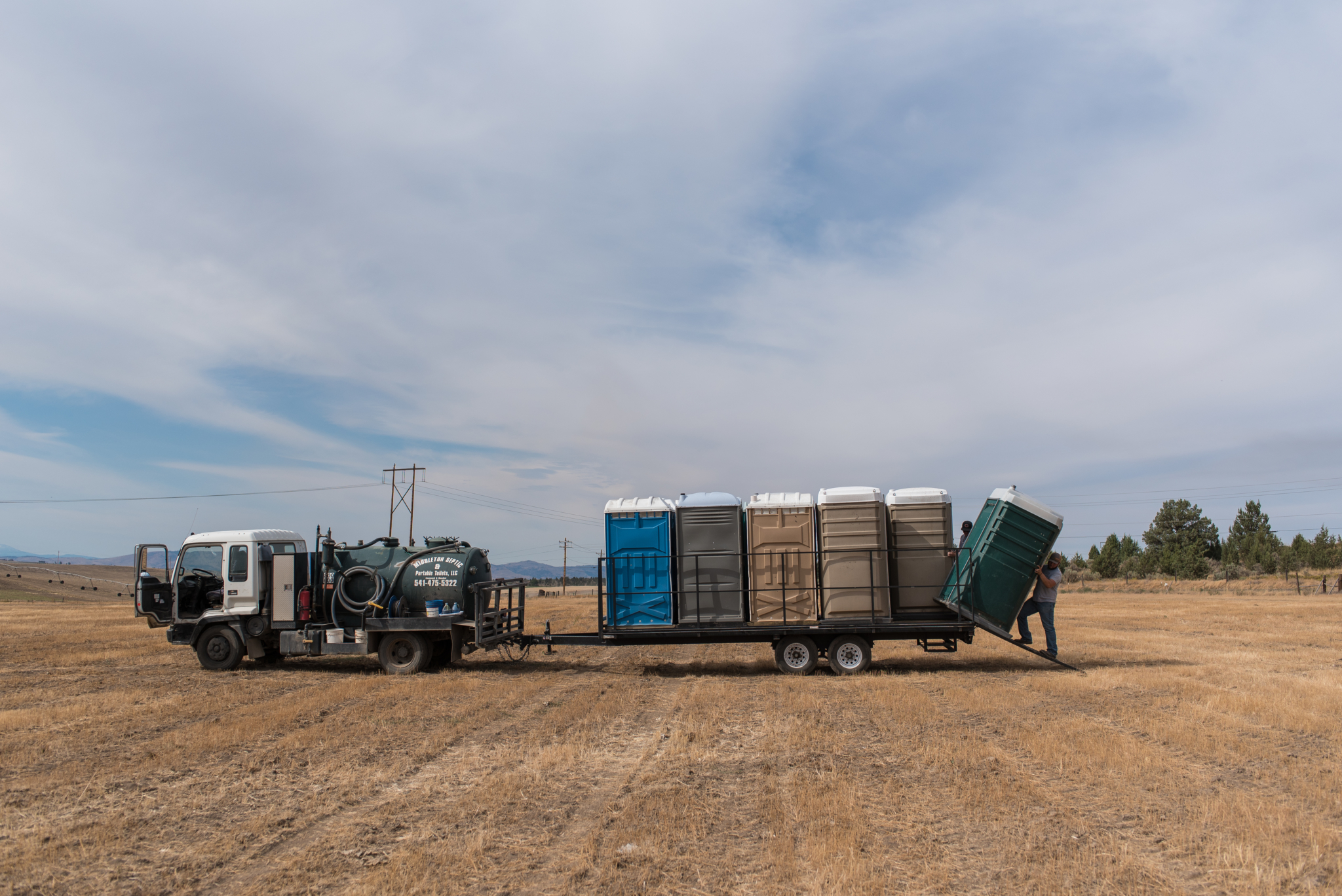 Middleton Septic & Portable Toilets worked to meet the high demand for portable toilets that has resulted from the influx of campers and tourists descending on Madras, Oregon, for the August 2017 total eclipse. Here crew members off-load units in a farm field.