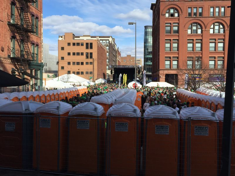 Crowds flow into a fenced area where many of Plummer's Disposal Service restrooms are set up for the one-day event. (Photo by Anya Plummer)