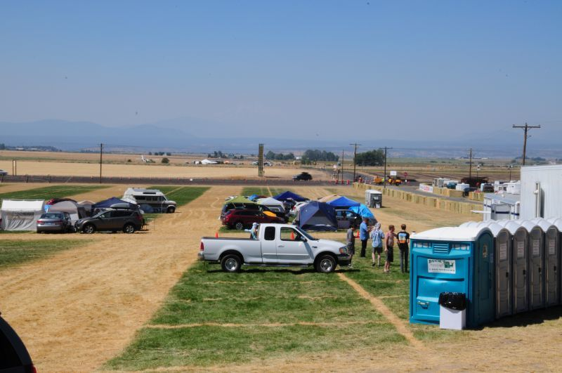 Campers set up early in Oregon farm fields. Parking near a bank of restrooms was a prime spot for solar eclipse watchers. (Photo by Bill Vollmer)